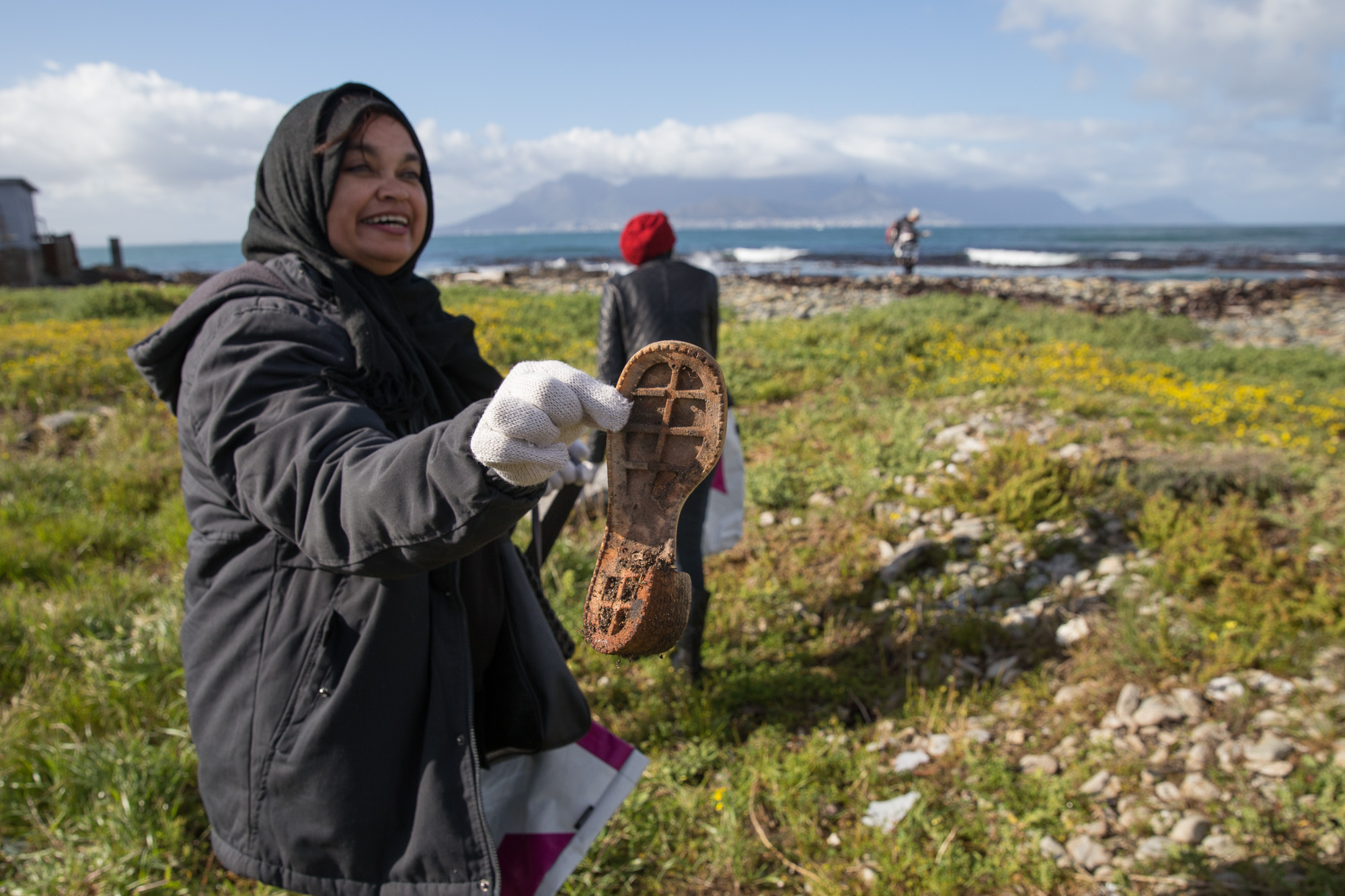 Volunteers get dirty to help free Robben Island from waste burden